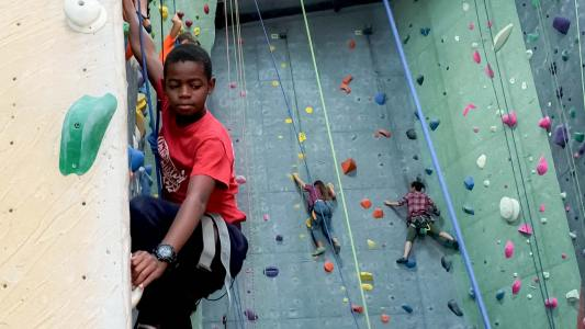 Rock climbers help refugees in America learn skills for the challenges of their new lives